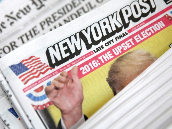 The cover of the New York Post newspaper is seen with other papers at a newsstand in New York, November 9, 2016