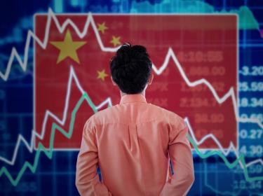 Man looking at chart of China's stock market