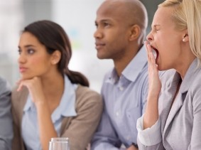 Woman yawning during a business meeting
