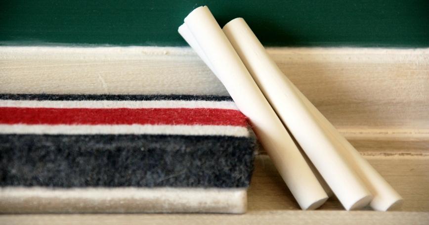 Chalk and eraser on chalkboard rail