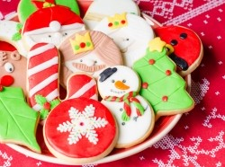 Plate full of colorful Christmas cookies