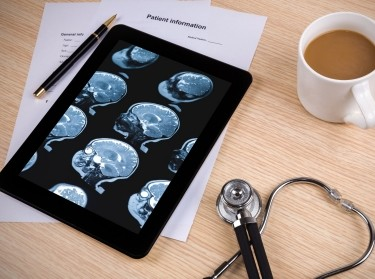 Digital Tablet with stethoscope and brain scan