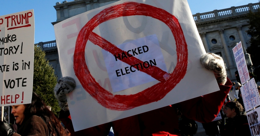 People protest as electors gather to cast their votes amid allegations of Russian hacking to try to influence the U.S. presidential election in Harrisburg, Pennsylvania, December 19, 2016