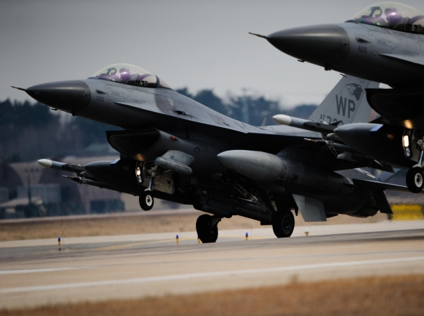 Two U.S. Air Force F-16 Fighting Falcons from the 35th Fighter  Squadron land in sync after a training sortie Feb. 13, 2014, at Kunsan Air Base, South Korea.