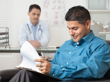 Patient filling out forms in a doctor's office