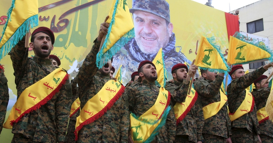 Hezbollah members salute during the funeral of Ali Fayyad, a senior commander who was killed fighting in Syria, Lebanon, March 2, 2016