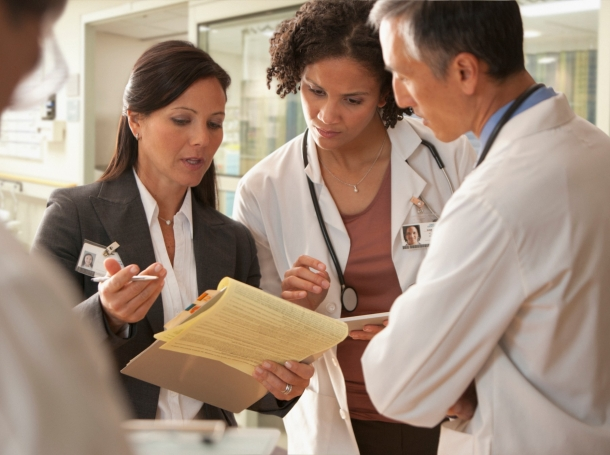 Hospital staff discussing a patient's chart