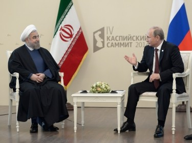 Russia's President Vladimir Putin (R) talks with his Iranian counterpart Hassan Rouhani as they meet during a summit of Caspian Sea regional leaders in the southern city of Astrakhan September 29, 2014