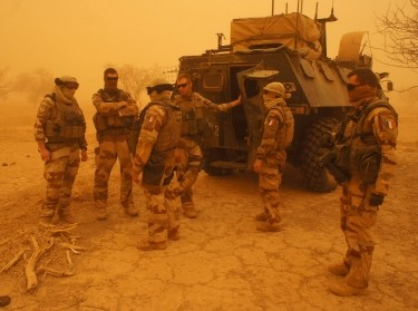 French soldiers from Operation Barkhane stand outside their armored personnel carrier during a sandstorm in Inat, Mali, May 26, 2016