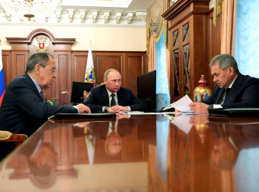 Russia's President Vladimir Putin (C), Foreign Minister Sergei Lavrov (L), and Defence Minister Sergei Shoigu attend a meeting at the Kremlin in Moscow, Russia December 29, 2016