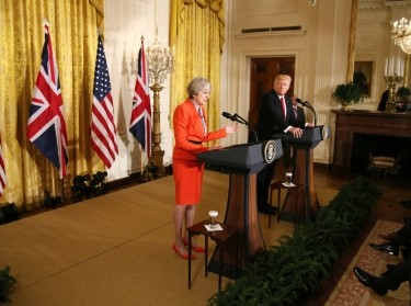 British Prime Minister Theresa May speaks as U.S. President Donald Trump listens during their joint news conference at the White House in Washington, U.S., January 27, 2017.