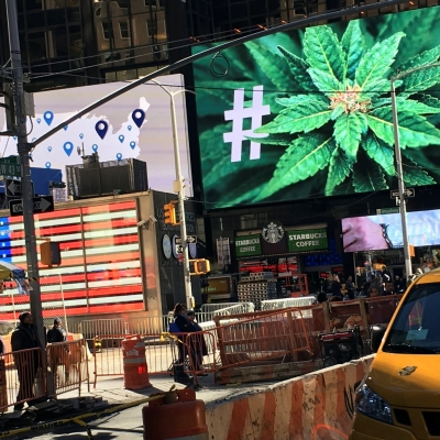 An electronic billboard displays a marijuana hashtag at Times Square in New York, November 7, 2016