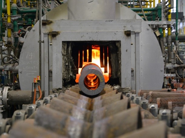 A 155 mm artillery tube enters a heat treatment furnace at Watervliet Arsenal to improve the microstructure and hardness of the steel