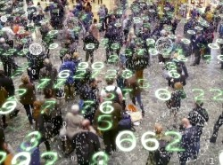 Binary code bursts from phones held by a crowd of people with an overlay of glowing electronic numbers, photo by peterhowell/Getty Images