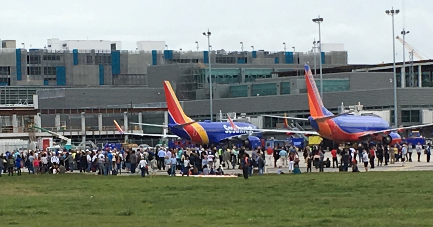 Travelers are evacuated out of the terminal and onto the tarmac after a shooting at Fort Lauderdale-Hollywood International Airport in Florida, January 6, 2017