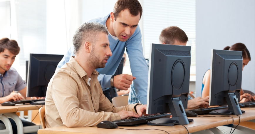 Adult students attending a computer course