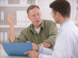 A doctor talking with a stressed patient