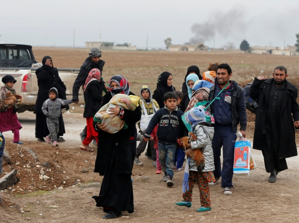 Displaced people who fled ISIS arrive at a military checkpoint before being transported to camps in eastern Mosul, Iraq, January 25, 2017