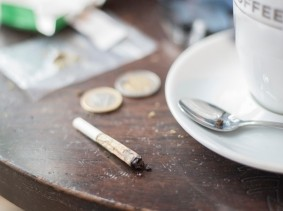 A marijuana joint on a coffeeshop table in Amsterdam, Netherlands