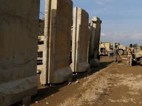 Iraqi army gather during a fight with Islamic State militants in Rashidiya, North of Mosul, Iraq, January 30, 2017.