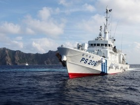 Japan Coast Guard vessel PS206 Houou sails in front of Uotsuri island, one of the disputed islands, called Senkaku in Japan and Diaoyu in China, in the East China Sea, August 18, 2013
