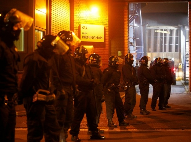 Police officers in riot gear stand outside Winson Green prison after a serious disturbance broke out, in Birmingham, Britain, December 16, 2016