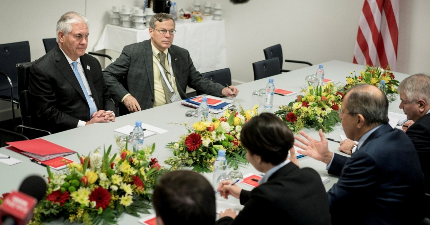 U.S. Secretary of State Rex Tillerson (L) listens to Russian Foreign Minister Sergei Lavrov (2ndR) at the start of a meeting at the World Conference Center in Bonn, Germany, February 16, 2017