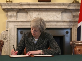 British Prime Minister Theresa May signs the official letter invoking Article 50 and the UK's intention to leave the EU, March 28, 2017, London