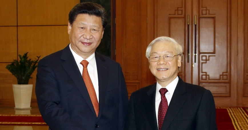China's President Xi Jinping and Vietnam's Communist Party General Secretary Nguyen Phu Trong shake hands at the Central Communist Party Office in Hanoi, Vietnam, November 5, 2015