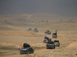 Counterterrorism service troops advance towards Ghozlani military complex, south of Mosul, Iraq, February 23, 2017