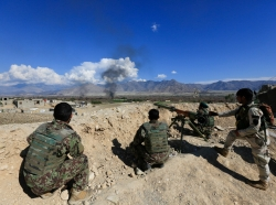 Afghan security forces take position during a gun battle between Taliban and Afghan security forces in Laghman province, Afghanistan, March 1, 2017