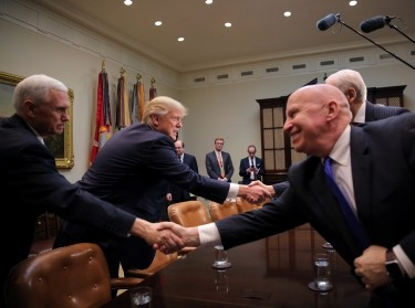 U.S. President Donald Trump and Vice President Mike Pence attend a meeting with congressional leaders to discuss trade deals at the White House in Washington, February 2, 2017