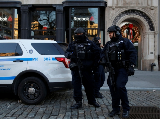 Members of the NYPD's Counterterrorism Bureau stand watch at the Union Square Holiday Market in Manhattan, December 20, 2016
