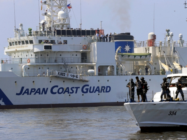 Philippine Coast Guard's Special Operations Group secures mock pirates during a rescue drill exercise with Japan's Coast Guard off Manila Bay, Philippines, July 13, 2016