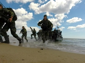 NATO Response Force and Allied Marines from the U.K., U.S., Sweden, and Finland simulate amphibious assaults on a Swedish beachhead during BALTOPS 2015