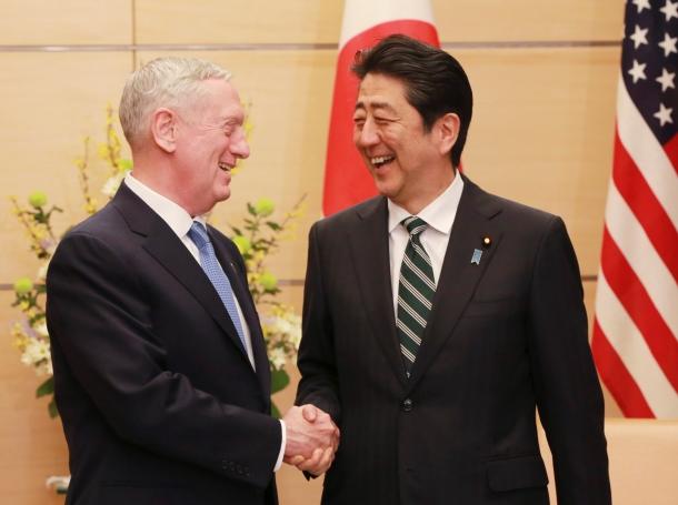 U.S. Defense Secretary James Mattis and Japanese Prime Minister Shinzo Abe shake hands at the prime minister's office in Tokyo, Japan, February 3, 2017