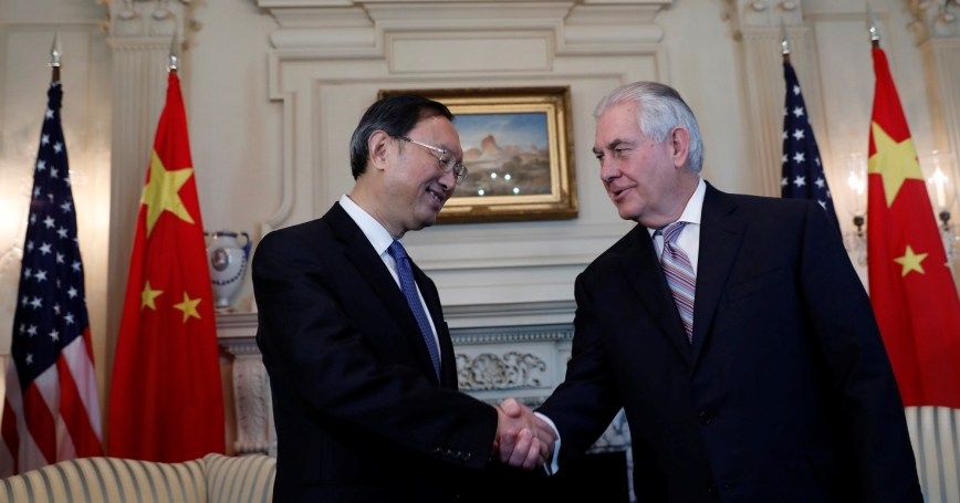 U.S. Secretary of State Rex Tillerson (right) greets Chinese State Councilor Yang Jiechi at the State Department in Washington, February 28, 2017