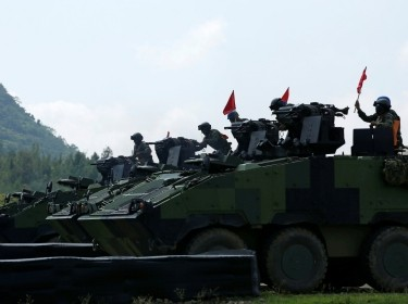 Soldiers drive a CM33 Clouded Leopard infantry fighting vehicle during the annual Han Kuang military drill simulating the PLA invading the island, in southern Taiwan, August 25, 2016