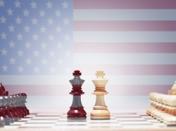 An American flag behind a chess board
