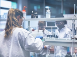 Group of scientists working in laboratory