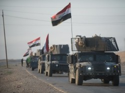 An Iraqi Counter Terrorism Service convoy moves towards Mosul, Iraq, February 23, 2017