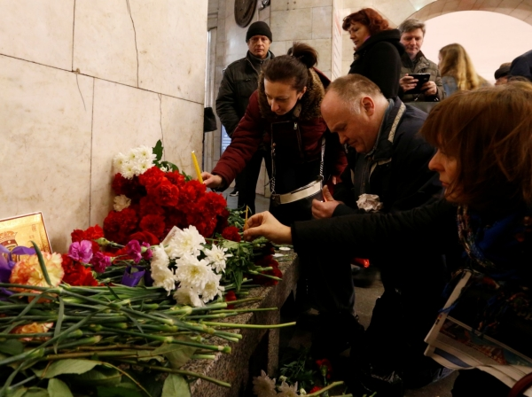 People leave candles in memory of victims of a blast in the St. Petersburg metro, Russia, April 4, 2017