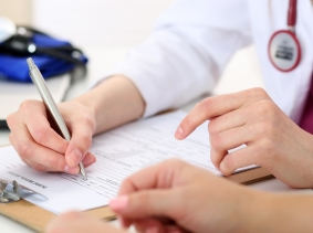 A doctor recording information with a patient