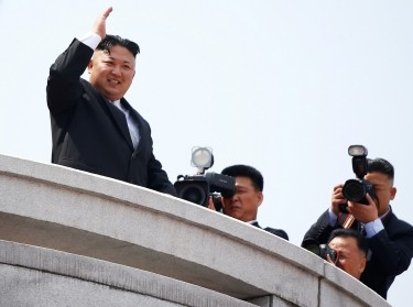 North Korean leader Kim Jong Un waves to people attending a military parade marking the 105th birth anniversary of country's founding father Kim Il Sung, in Pyongyang April 15, 2017.
