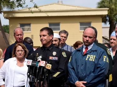 Orange County Mayor Teresa Jacobs, Orlando police chief John Mina, and FBI agent Ron Hopper at a news conference after the attack at Pulse nightclub in Orlando, Florida, June 12, 2016