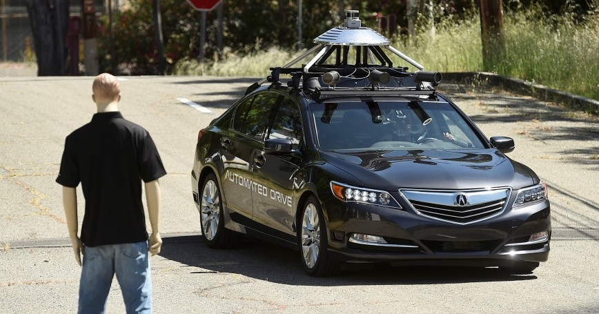An autonomous version of Acura's RLX Sport Hybrid SH-AWD navigates around a dummy at carmaker Honda's testing grounds at the GoMentum Station autonomous vehicle test facility in Concord, California June 1, 2016