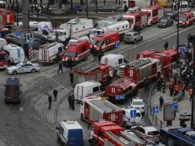 Emergency services attend the scene outside Sennaya Ploshchad metro station in St. Petersburg, Russia