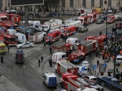 Emergency services attend the scene outside Sennaya Ploshchad metro station in St. Petersburg, Russia