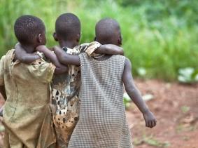 Three children in Bar Kawach, Barlonyo, Uganda