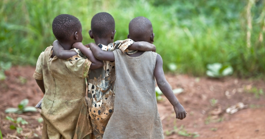 Three children in Bar Kawach, Barlonyo, Uganda